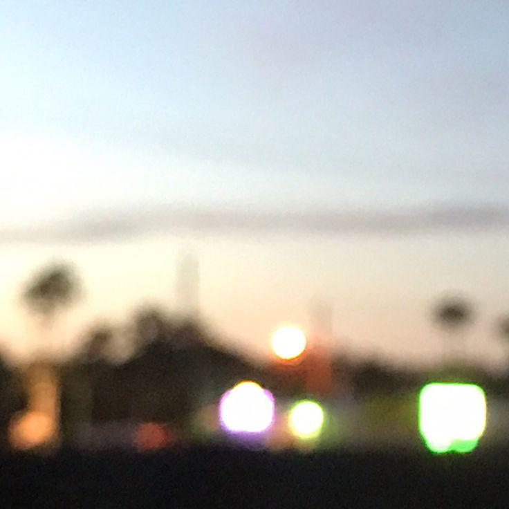 It's a figure of speech . . . . #noedit #outoffocus #blur #neon #sunset #sign #signs #billboard #green #yellow #pink #blue
