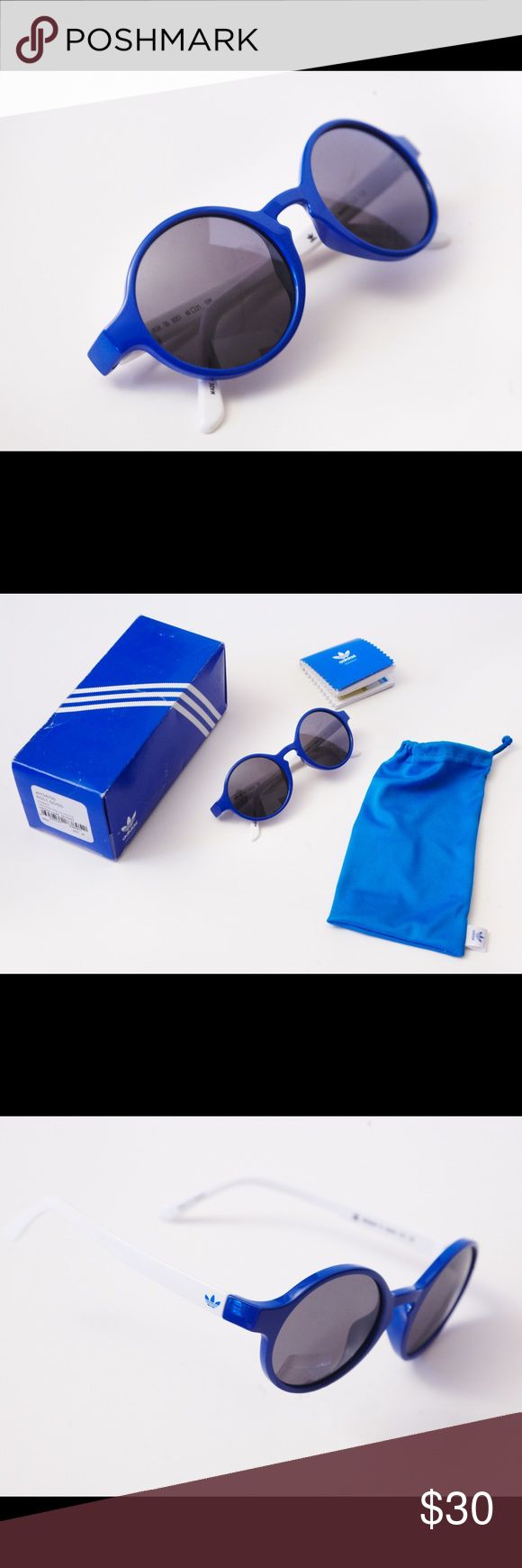 Womens Adidas Sunglasses Plastic Adidas women's round sunglasses   They are designed with a lightweight frame with a shaped nose bridge for comfort. UV protection of at least 100%.  These sunglasses also come with a soft microfibre cloth pouch and a woven pouch to store your sunnies when not in use, the box tags and product Brochure are also included.  adidas branding completes the look. Adidas Accessories Sunglasses