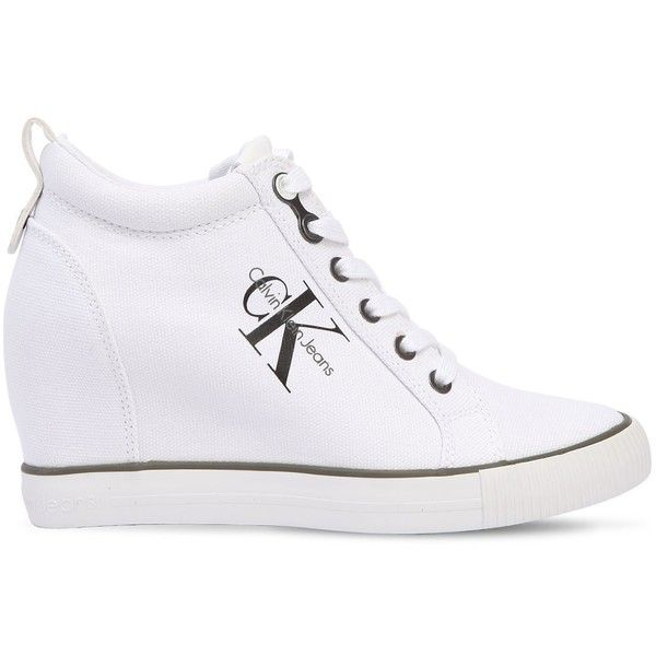 Calvin Klein Jeans Women 70mm Ritzy Cotton Canvas Wedge Sneakers ($155) ❤ liked on Polyvore featuring shoes, sneakers, white, white wedges shoes, white eyelet shoes, wedge heeled shoes, white wedge heel sneakers and sneaker wedge shoes