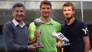 Thomas Mueller (C) recieves the adidas silver Ball as second best player of the FIFA World Cup 2014™ and the adidas silver boot for the second best goalscorer of the World Cup from Herbert Hainer, CEO adidas group (L) and his Brother Simon Mueller (R) at the adidas headquarter in Herzogenaurach. 6th October 2014.
