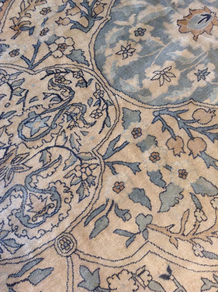 Details of an elegant antique Persian Kirman rug in soft blues, beiges, ivory and tan.