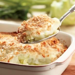 If you haven't tried kohlrabi, which tastes like a mild, sweet turnip, this gratin is an excellent place to start—after all, what doesn't taste good with cheese sauce on it? Kohlrabi that are less than 3 inches in diameter will give you the most tender results.