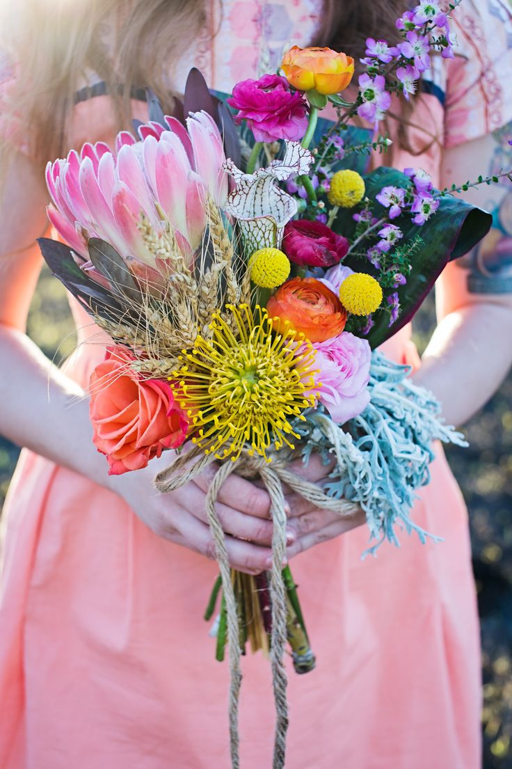 Absolutely stunning bouquet. Full of life and color! Photography: Manstrom Photography - www.manstromphotography.com Read More: http://www.stylemepretty.com/2014/07/09/north-dakota-handmade-inspired-vow-renewal/