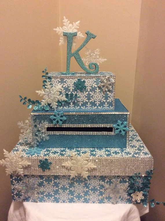 This is a three tiered card box with a snowflake/winter wonderland theme. You wont find this cheaper. PERIOD. if you do I will match the