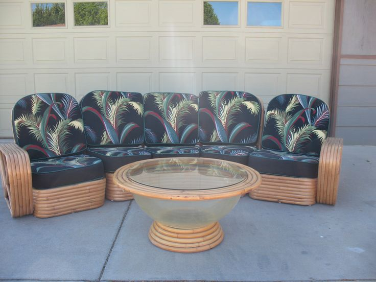 Curved Rattan Frankl Sofa with obscure coffee table fishbowl