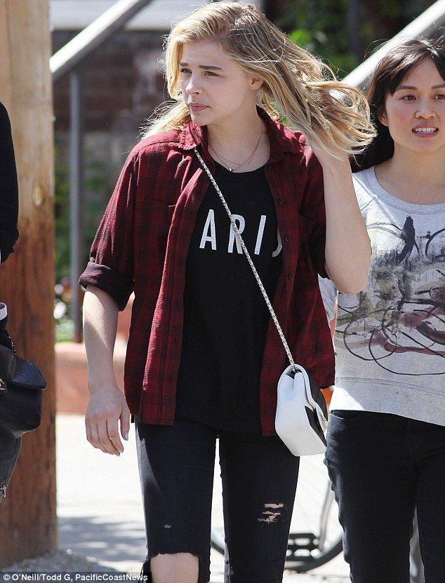 Casual customer: The Kick-Ass star wore her favourite pair of slim black ripped jeans, a red flannel shirt, black T-shirt and a pair of black leather slip-on sneakers on the daytime outing