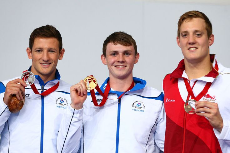 Gold medallist Ross Murdoch (C) of Scotland poses with silver medallist Michael Jamieson of Scotland and bronze medallist Andrew Willis of England