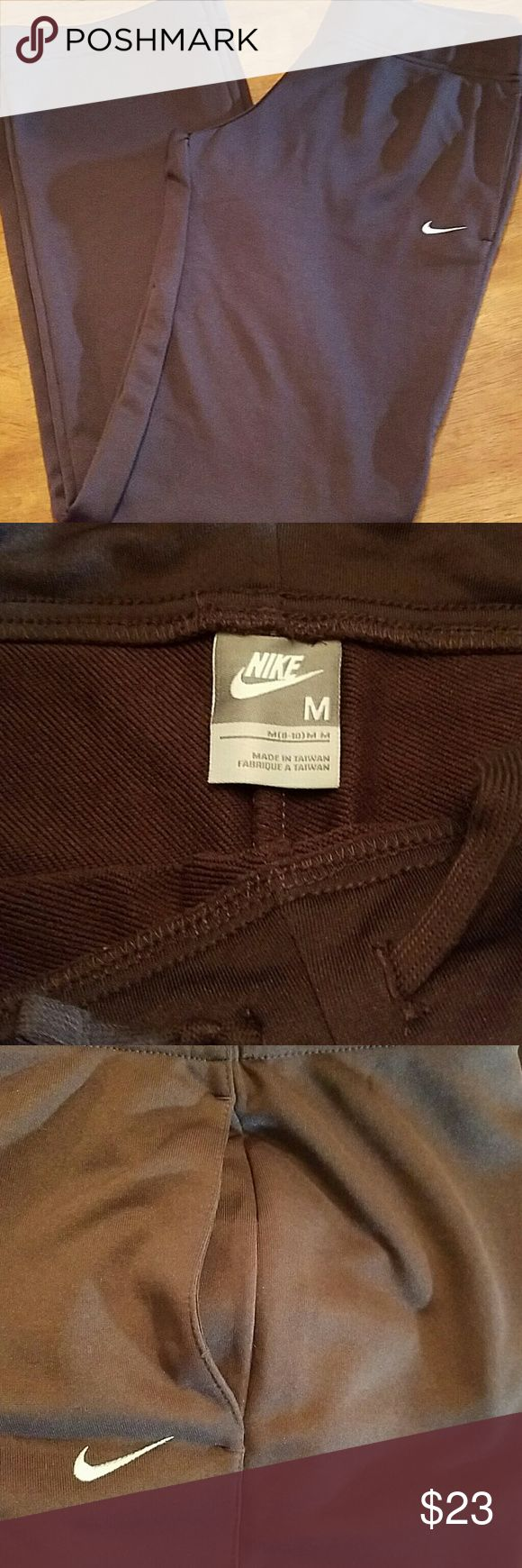 Nike athletic pants ladies size medium Ladies Nike athletic pants in excellent condition they are chocolate brown and have side pockets in a drawstring waist easier to high-quality Nike slacks that you can wear as athletic or everyday. These are great pair of pants. They have a 32 inch inseam size medium and are from a clean non-smoking home. Price is not negotiable. Thank you Nike Pants