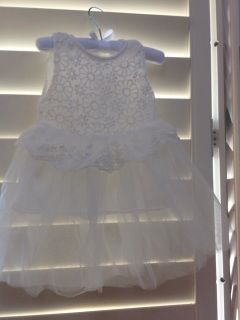 Beautifully cute unique white tulle dress with floral bodice for the littlest Princess in your life. Polyester with lace embellishments  MONEY BACK GUARANTEE - see our terms and conditions   BUDGET BRIDAL