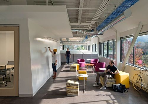Creative & collaborative space. Like the openness (outdoor view, a common place where people can walk by, be inspired and may join the discussion) and convenience (go inside the room: focus work mode, just behind the wall/outside: collaborative space)