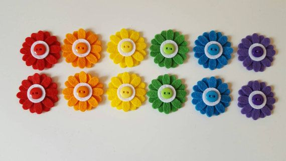Check out this item in my Etsy shop https://www.etsy.com/uk/listing/473511441/12-handmade-daisy-embellishments-rainbow