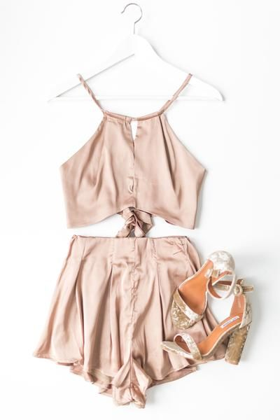 Delicate shiny satinhalter crop top that ties in the back with a thin slit in front, and flowy high waist bottoms with a hidden back zipper. Open criss-cross s