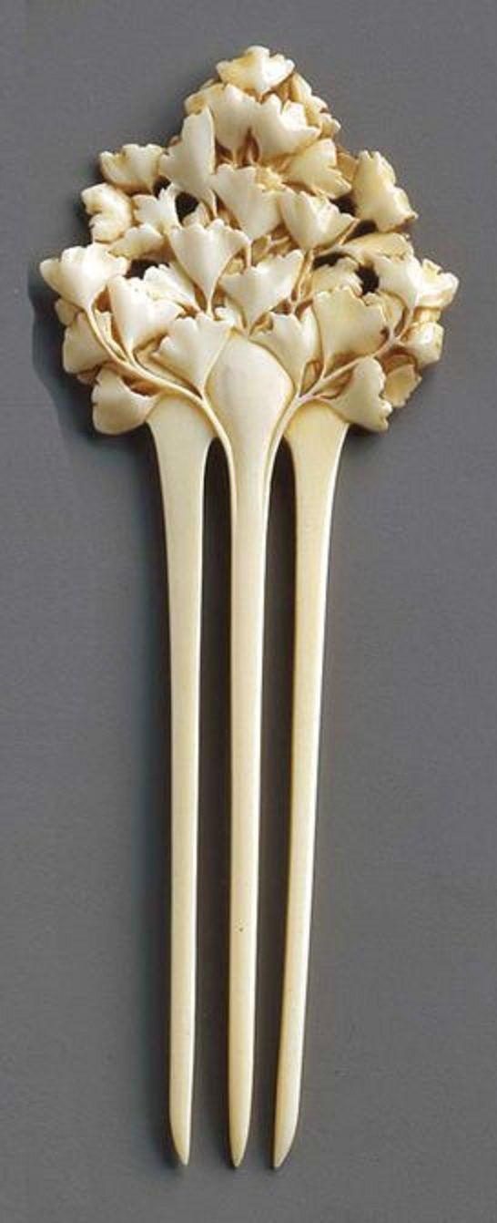 HENRI EDMOND BECKER - An Art Nouveau carved and painted ivory comb, circa 1902. Bearing the monogram of the artist on the reverse.