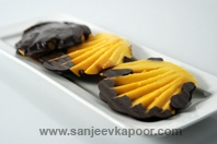 Chocolate Coated Mango-Mango pieces dipped in melted dark chocolate.
