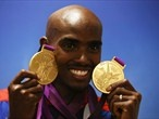 Gold medalist Mohamed Farah of Great Britain poses with his medals for the 10,000m and 5000m