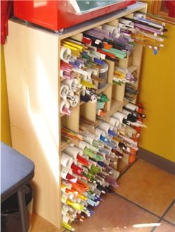 Glass rod storage; A basic shoe organizer from Target and some PVC pipe created the perfect storage area.