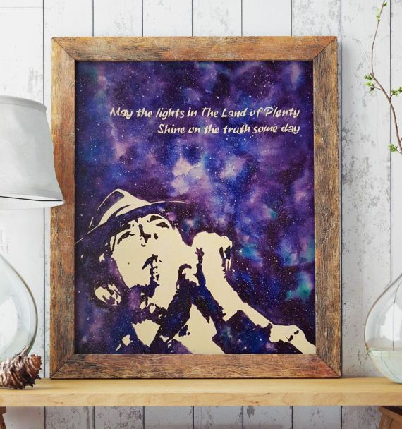 For all the Leonard Cohen fans out there, here is your poster! Leonard Cohen silhouette with galaxy background and the lyrics from the song Land of Plenty: May the lights in the Land of Plenty shine on the truth some day  Instant download jpeg file at high resolution, can be printed on large formats of paper or canvas.  Check out the rolled canvas and framed canvas versions of this artwork: https://www.etsy.com/listing/507230248/leonard-cohen-art-poster-rolled-canvas?...