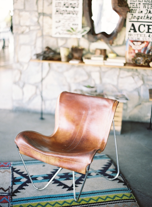 Leather butterfly chair | Concrete Floor I Plumber Pipe Shelves I Southwestern Rug I Succulents I Ace Hotel Palm Springs |