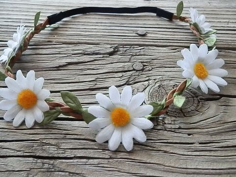 Bright and beautiful! This headband is Hand crafted from mini white daisy flowers with rhinestone middle fabulously adorned on a Braided Faux suede and Garland headband. And of course a elastic back for the best comfort ability. Picture yourself wearing this to your next festival, concert even a ...