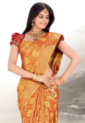 Orange and mustard zari woven pure kanchipuram silk saree highlighted with tassels . Accessories shown in the image is just for photography purpose. As shown red blouse can be made available and also can be customized as per your style or pattern subject to fabric limitation. (Slight colour variation is possible.)