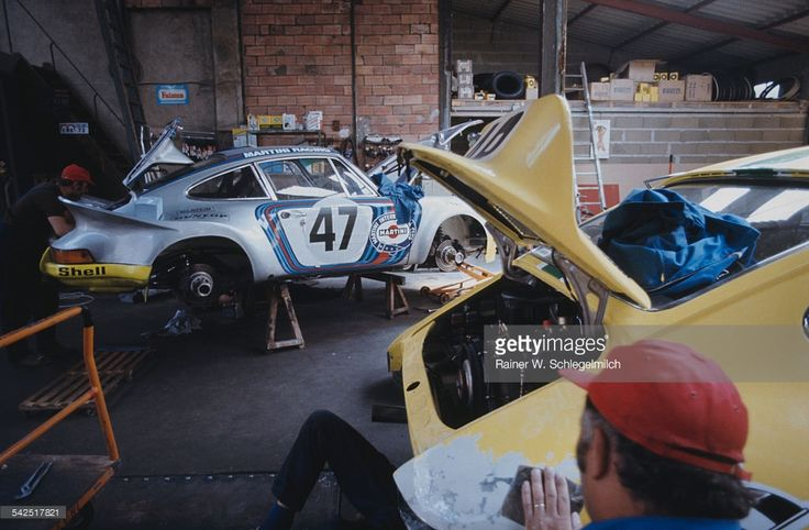 The #47 Martini Racing Team Porsche 911 Carrera RSR in the pits during the World Sportscar Championship 24 Hours of Le Mans race on 9th June 1973 at the Circuit de la Sarthe, Le Mans, France. (Photo by Rainer W. Schlegelmilch/Getty Images