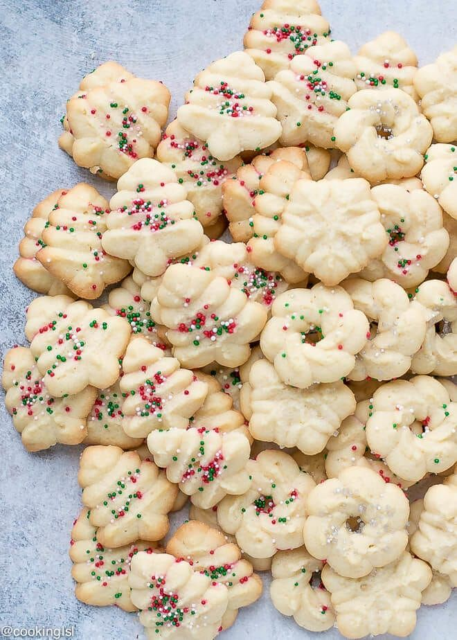 Easy Cream Cheese Spritz Cookies Recipe , on a platter, made using OXO cookie press with wreath, snowflake and Christmas tree disks