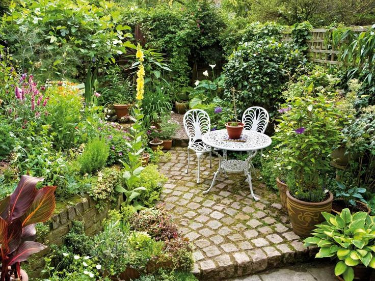 Small Garden in The Backyard Design Ideas with white chair and white table