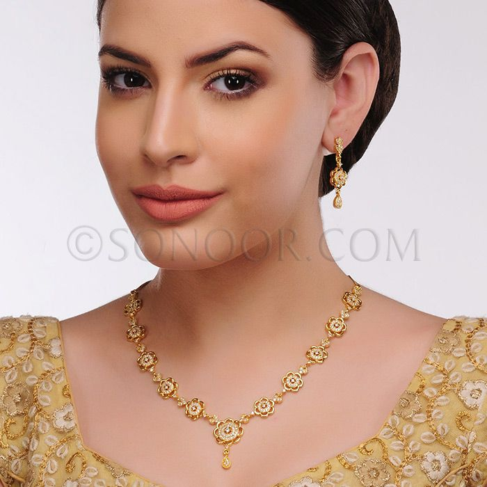 NEC/1/3449 Arpali Necklace Set with Earrings dull gold finish studded with cubic zircons $78£46