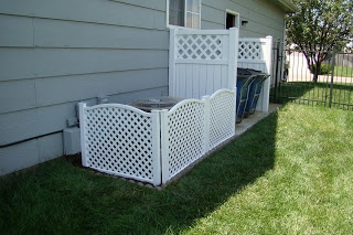 Cool way to hide the ac unit and the garbage cans
