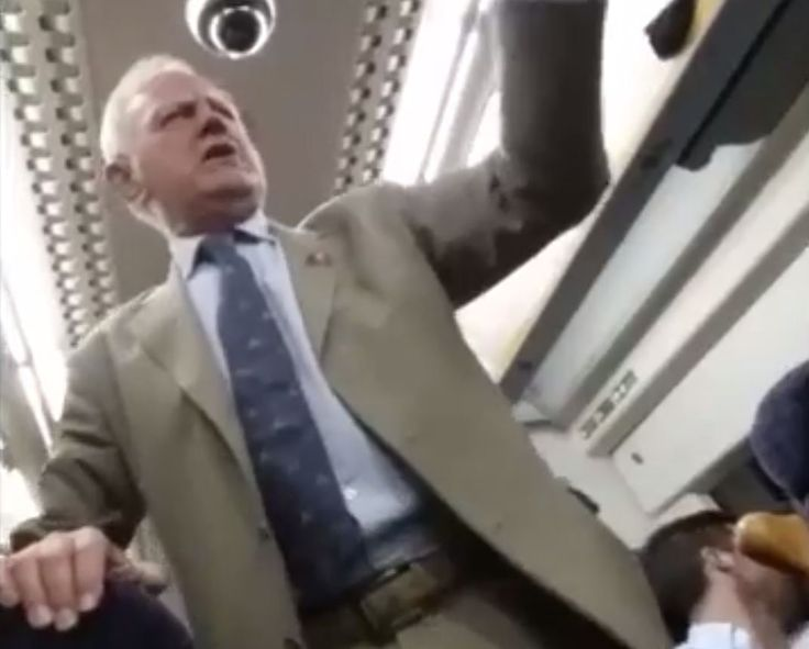 Drunk guy conducts train sing-a-long and everyone loves it