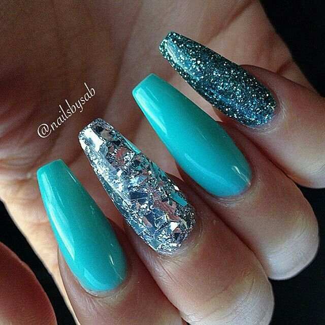 Teal aqua blue long coffin nails. That bling on the middle finger is so beautiful... looks like some fragments of broken mirror. I love it. #nail #nailart #glitter
