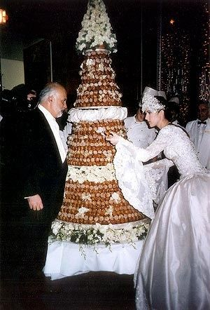 Celine Dion and her husband, Rene Angelil, with their massive French profiterole wedding cake made in a Christmas tree formation.