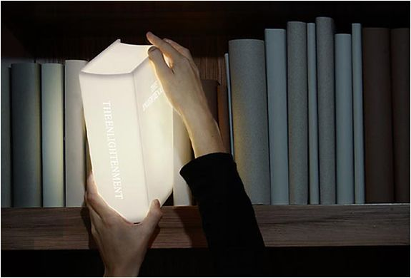 """BOOK LAMP.""""Enlightment  Book"""",Led lamp. Click onto picture & you can buy it for $99.00 on page 16."""
