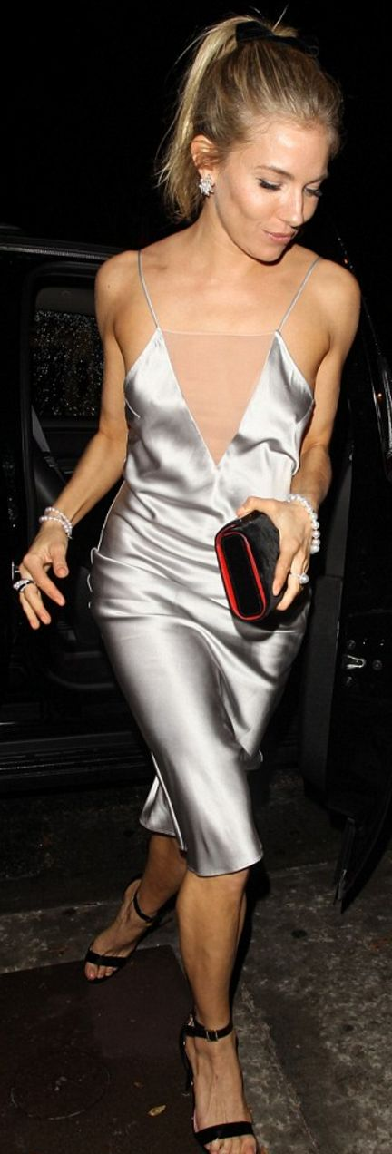 Who made Sienna Miller's gray spaghetti strap dress, black clutch handbag, and jewelry?
