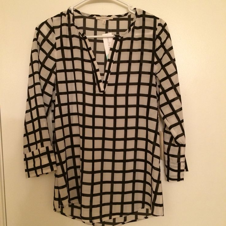 Love the style and the fit of this shirt in my 2nd Stitch Fix! Plus, the sleeves roll up and attach with a little button.