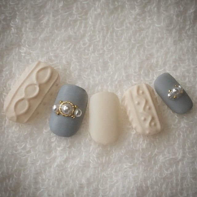 Pieces of art.  Ivory and Gray nails
