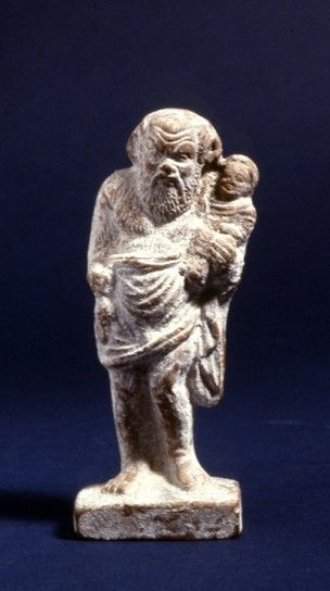 Terracotta figure of a comic actor from a satyr play, probably Silenos holding the infant Dionysos.