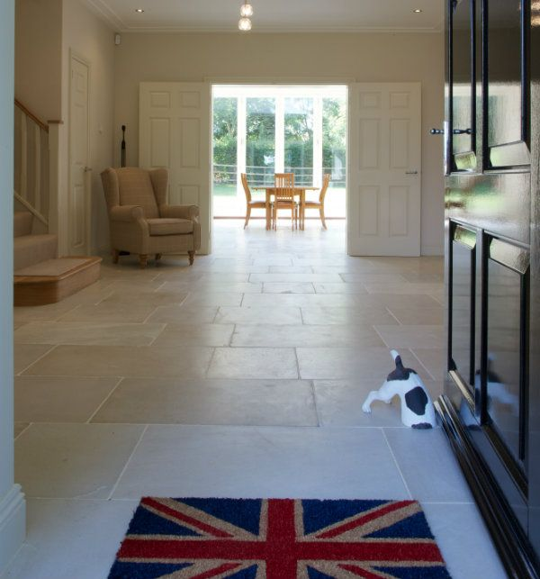 Dorchester Sandstone in a tumbled finish. Beautiful sandstone floor tiles look beautiful on the floor in a hallway.