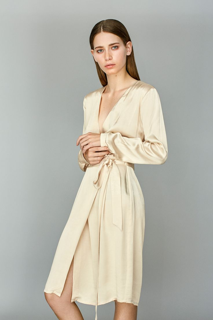 Smilla Satina is an elegant and feminine dress.  The dress has a wrap-around effect with a drawstring waist, which makes it also is current as kimono