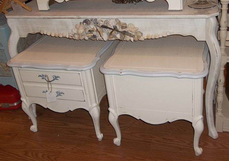 A sofa table that I painted, sanded and waxed then applied seashells and treasures to the skirt front