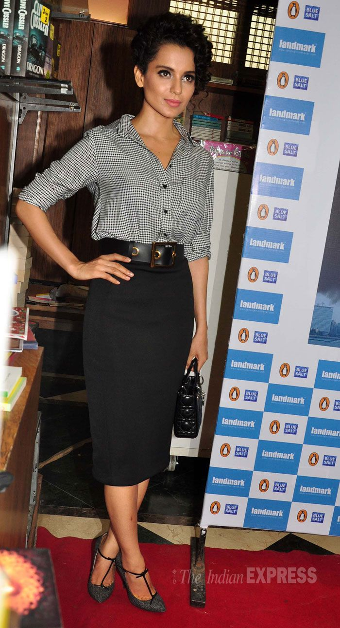 Kangana Ranaut looking chic in a monochrome shirt-blouse paired with a black pencil skirt. #Fashion #Style #Bollywood #Beauty