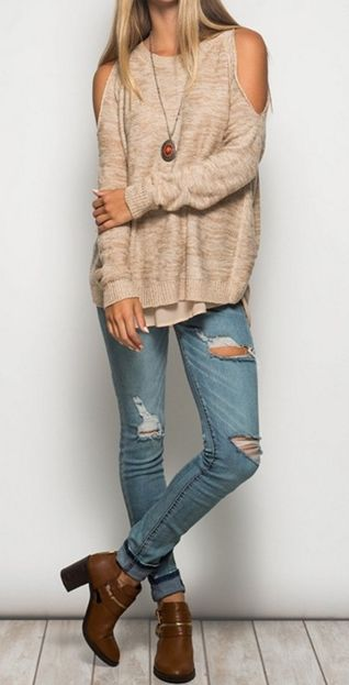 Taupe long sleeve cold shoulder sweater with chiffon contrast. 65% Cotton, 35% Acrylic.
