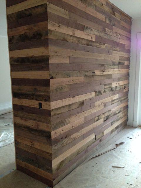 Reclaimed lumber mixed wood wall of clean top oak walnut
