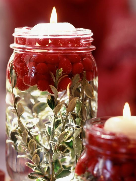 Easy and inexpensive Cranberry Candle- mason jar, boxwood, cranberries, water and a floating candle.