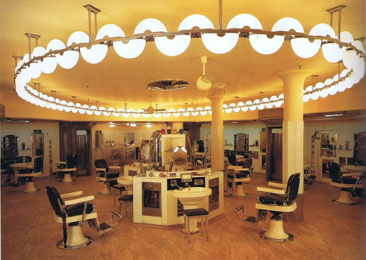 1929-30Art Deco Interiors The Barber Shop in the Austin Reed store in London's Regent Street featuring Vitrolite, chrome, marble, frosted glass and suspended arcs of undulating neon tubing. Created by P.J. Westwood