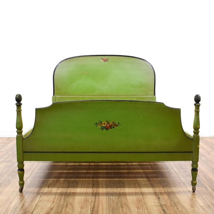 This queen sized bed is featured in a solid wood with a pear green paint finish. This cottage chic style bedframe has carved turning bed posts, beautiful floral accents on the headboard and footboard, and black trim. Perfect for getting beauty sleep! #cottagechic #beds #bedframe #sandiegovintage #vintagefurniture