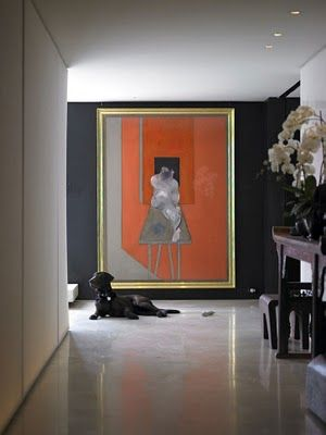 orange art focal point in a hall... Dark accent wall, art size, frame... Dog