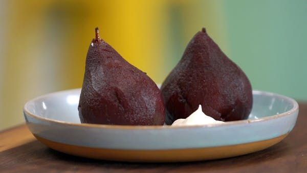 Recipe with video instructions: Much like ourselves, these poached pears are full of holiday spice and drunk on red wine. Ingredients: 2 pears, ripe, 3 cups red wine, 1 cinnamon stick, 3 cloves, 1 vanilla pod, scraped, 1 piece orange peel, 2 allspice berries, 1 bay leaf, 3 black peppercorns, 1/4 cup sugar, Whipped cream, to serve