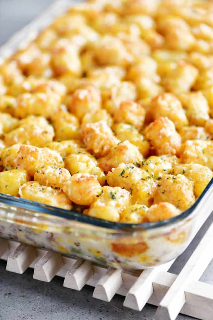Tater Tot Casserole Has A Creamy Layer Of Ground Beef Italian Sausage Green Beans And Corn Topped Tater Tot Casserole Italian Sausage Ground Sausage Recipes