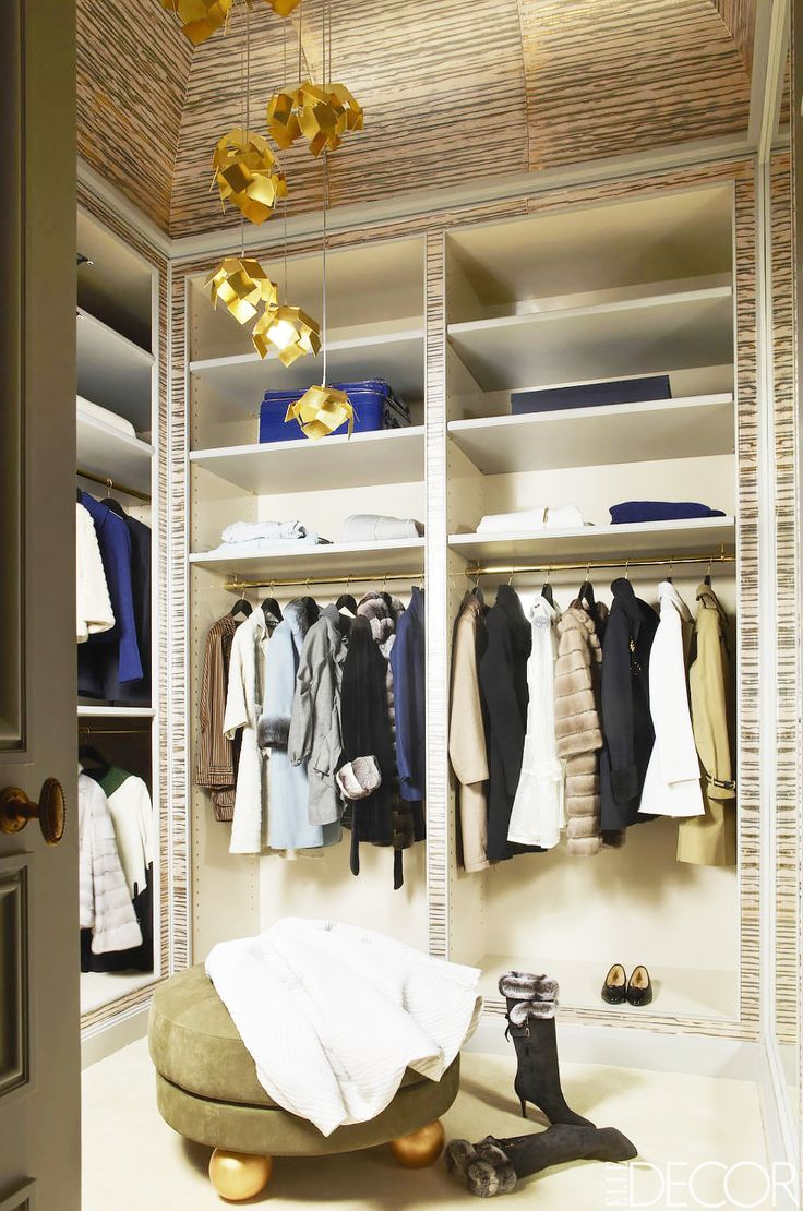 A Parisian closet with textured wall coverings, soaring ceilings, and sculptural lighting